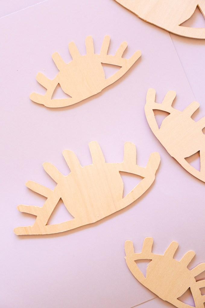 wooden eye-shaped valentines cut from a Cricut Maker