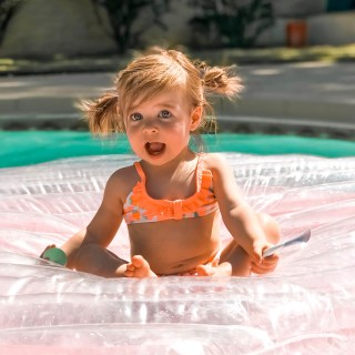 toddler girl in swimsuit