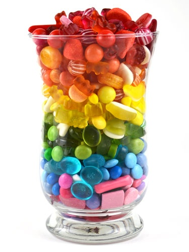 Glasses filled with sweets would be a great reminder of the colours in Munchkin Land