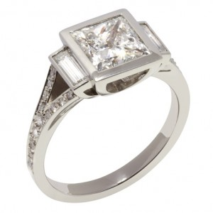 £18,995 Art Deco inspired ring featuring a princess cut centre and baguette diamonds either side.