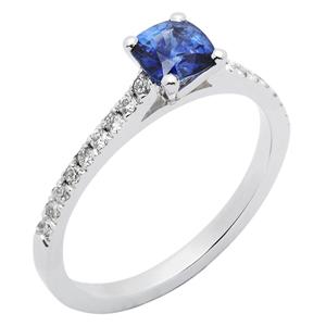 £1,750 A delicate cushion cut sapphire ring, enhanced with diamond shoulders
