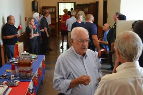 Joe Giadone Speaking with Attorney John Lefferdink at Retirement Party