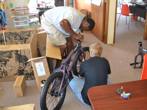 LaTour and a Student Finish Up a Bike