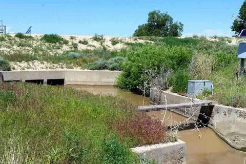 Headgates of the Highland Ditch on the Purgatoire River in Bent County releasing water now running into John Martin Reservoir to create a permanent pool. Courtesy Colorado Parks and Wildlife.