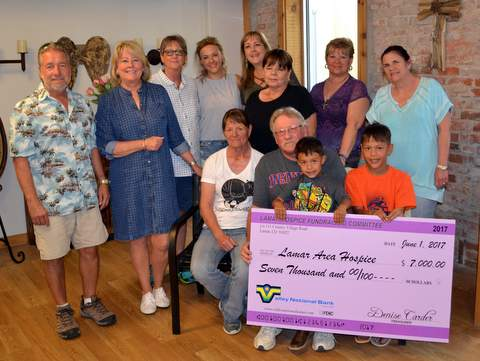 Hospice Fundraising Committee, and the Gruber's with Pirate Party Donation Check