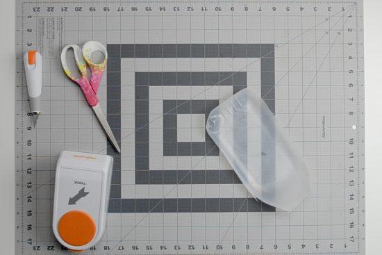 Supplies on a Fiskars cutting mat.