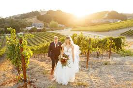 Walking down the aisle in a vineyard.