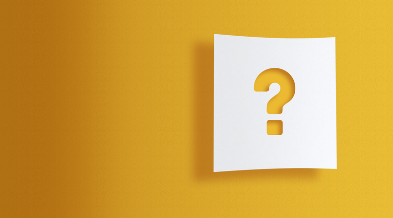 question mark on white information paper on yellow background