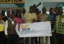 Nana Dwomoh Brobbey, presenting the cheque for GHc25,430 to Mr. Frederick Adjei-Rudolph, (right) GTA Eastern Regional Manager