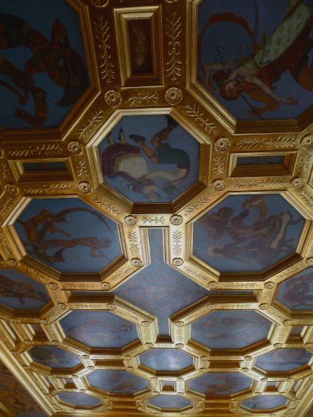 """The gilded ceiling features twenty-two depictions of dancing couples from various nations called, """"Dancers of Nations"""". These octagonal canvases were painted by book illustrator Willy Pogany in his New York studio, and applied to the ballroom ceiling in 1926."""