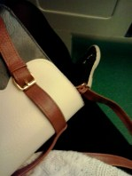 A photo I took on the train to show my sister how I had matched my clothes like a navy-cream boss
