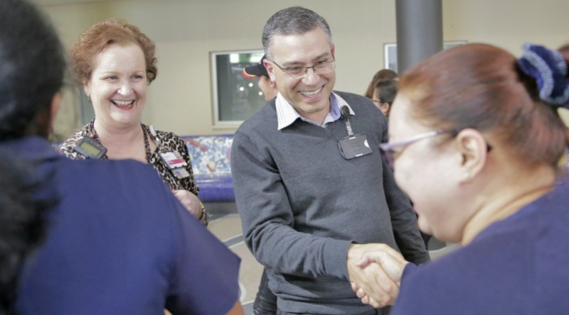 Peter Rophail and Brownyn Merritt at the WSLHD Wellbeing Festival laughetr class at Blacktown Hospital.
