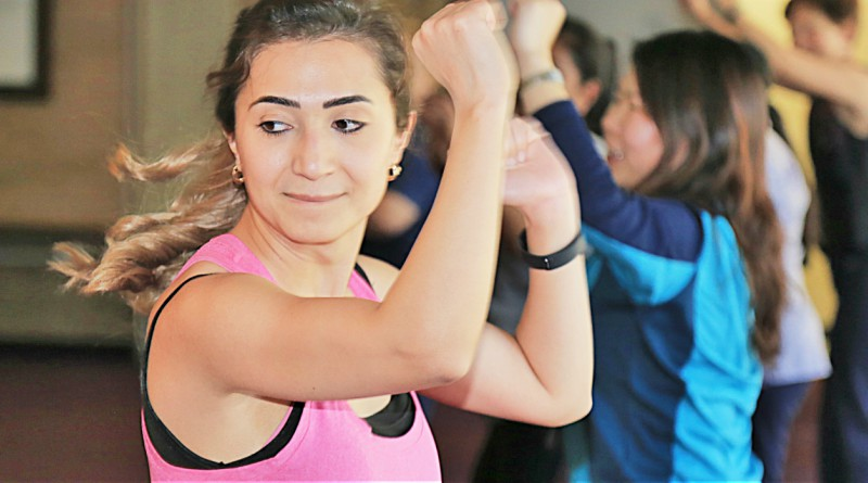 Nour Alatari, from clinical governance, gets moving at zumba at Westmead Hospital, part of the Wellbeing Festival.