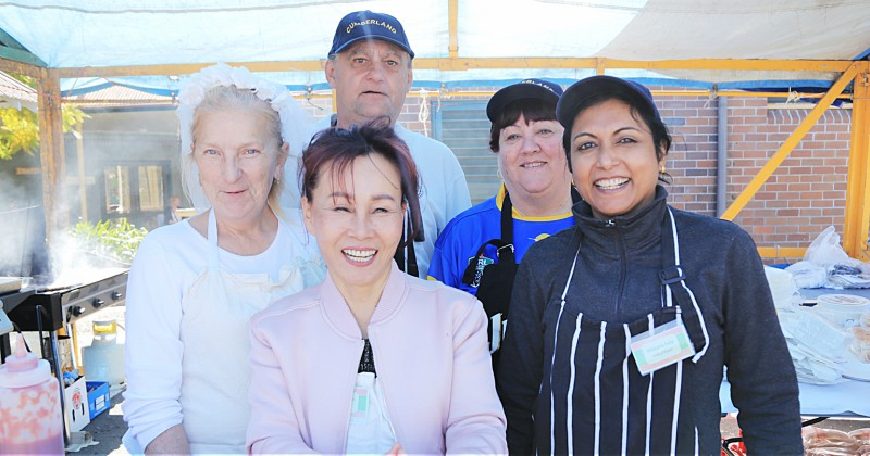 General services staff manned the barbecue at the Wistaria Festival:. Pictured are Shelley Arech, Zeljko Mabic, Young Hee Riemeyer Sharon Riches and Reena Uthappa.
