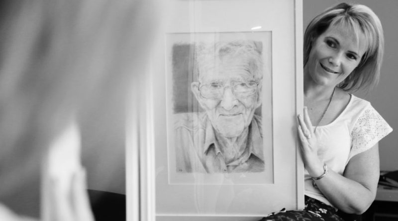 Julie Jones with an artwork of her late grandfather.
