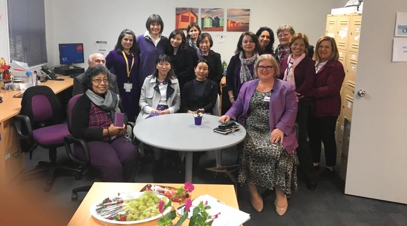 Health care interpreters celebrate the launch in purple.