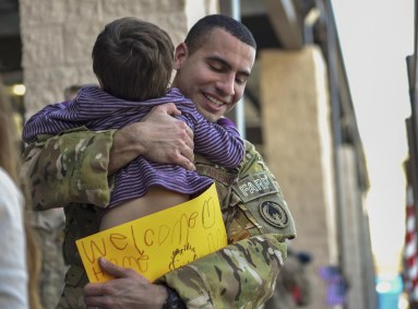 Staff Sgt. Codie Thibodaux, a fuels specialist with the 1st Special Operations Logistics Readiness Squadron, embraces his son during an Operations Homecoming at the Deployment Control Center on Hurlburt Field, Jan. 13, 2016. Operation Homecoming brought approximately 80 Airmen home from their deployment overseas. (U.S. Air Force photo by Senior Airman Ryan Conroy)
