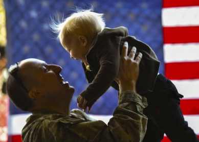 Master Sgt. David Thieme, superintendent of the 25th Intelligence Squadron, reunites with his son, Ezekiel, during an Operation Homecoming at the Deployment Control Center on Hurlburt Field, Fla., Jan. 13, 2016. Operation Homecoming brought approximately 80 Airmen home from their deployment overseas. (U.S. Air Force photo by Senior Airman Ryan Conroy)