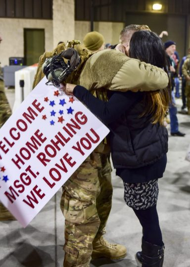 Master Sgt. Nick Rohling, a flightline expeditor with the 801st Special Operation Aircraft Maintenance Squadron, hugs his wife during Operation Homecoming at Hurlburt Field, Fla., Feb. 7, 2016. Operation Homecoming welcomed 106 Airmen home from their deployment overseas. (U.S. Air Force photo by Senior Airman Jeff Parkinson)