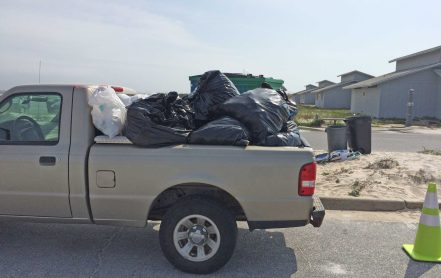 In a provided photo, trash is left at the Perdido Key area of Gulf Islands National Seashore.