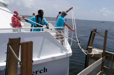 Crew members aboard one of Pensacola's new ferry boats prepare to cast off. (Bruce Graner/The Pulse)