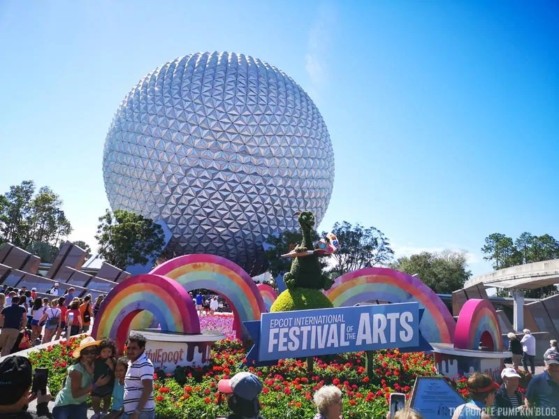 Figment Topiary with Festival of the Arts Sign and Spaceship Earth in the background