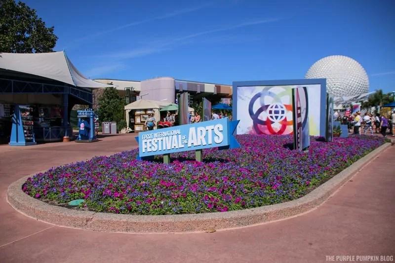 Epcot International Festival of the Arts sign with Spaceship Earth in the background