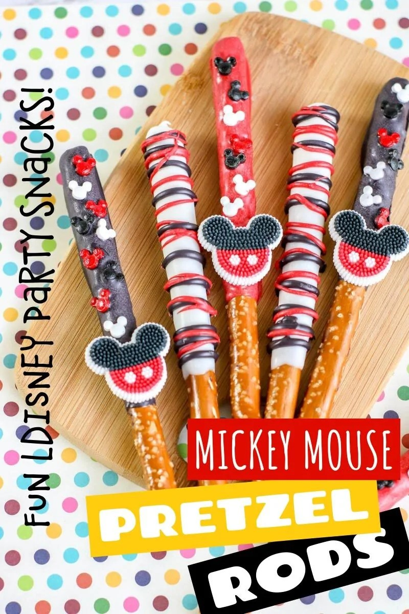 "Pretzel Rods decorated with melted candy and Mickey Mouse shaped sprinkles and icing decorations on a wooden board placed on a polka dot background with text overlay saying""Fun Disney Party Snacks! - Mickey Mouse Pretzel Rods"" Photos of the recipe dish from various angles are used throughout and with different text overlay unless otherwise described."