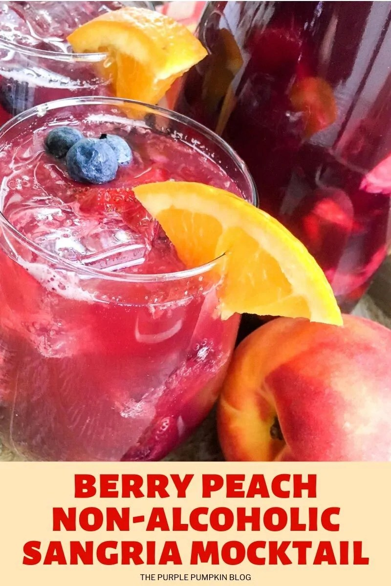 A glass of (red) berry peach non-alcoholic sangria garnished with orange wedge and fresh blueberries. Images of the same cocktail featured throughout with different text overlay unless otherwise described.