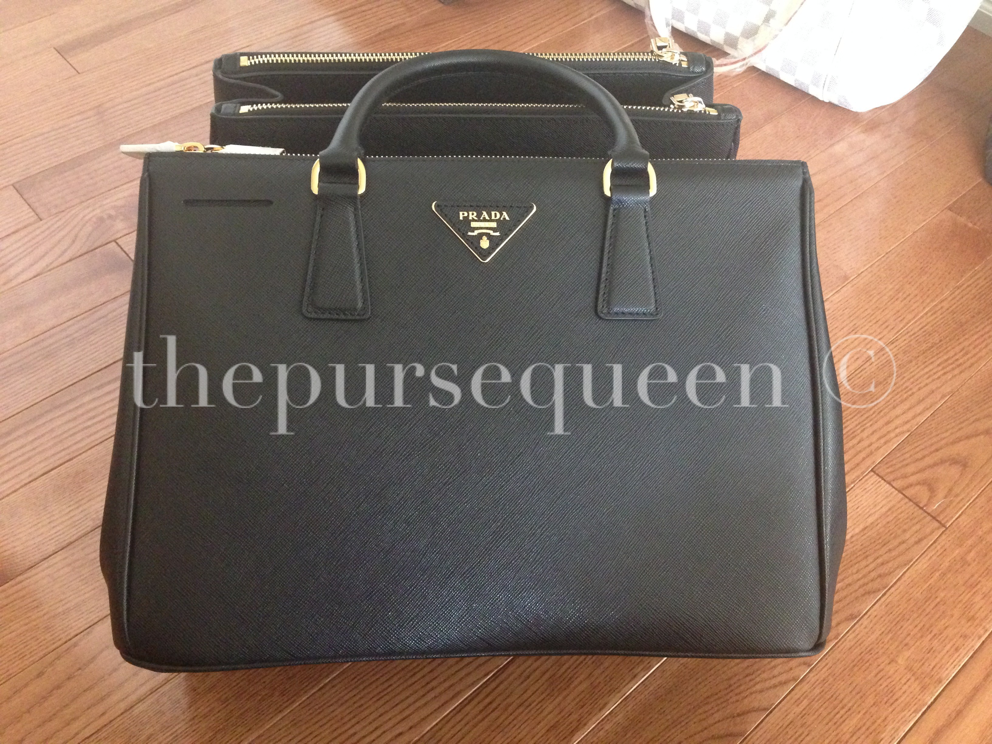 36db1801870c ... replica handbag a poor one! authentic prada saffiano black doublezip  tote gold hardware