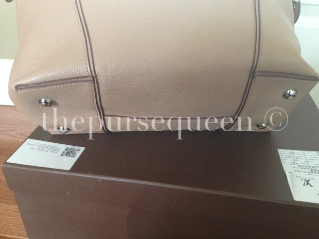 louis vuitton soft lockit beige replica vs authentic fake vs real bottom of bag