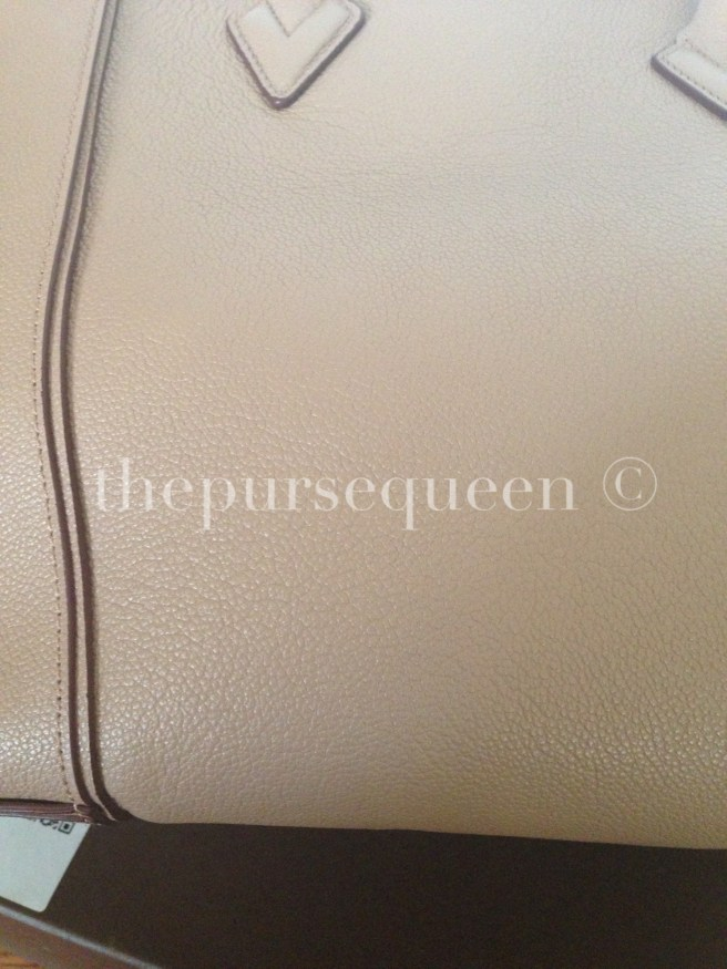 louis vuitton soft lockit beige replica vs authentic fake vs real leather closeup