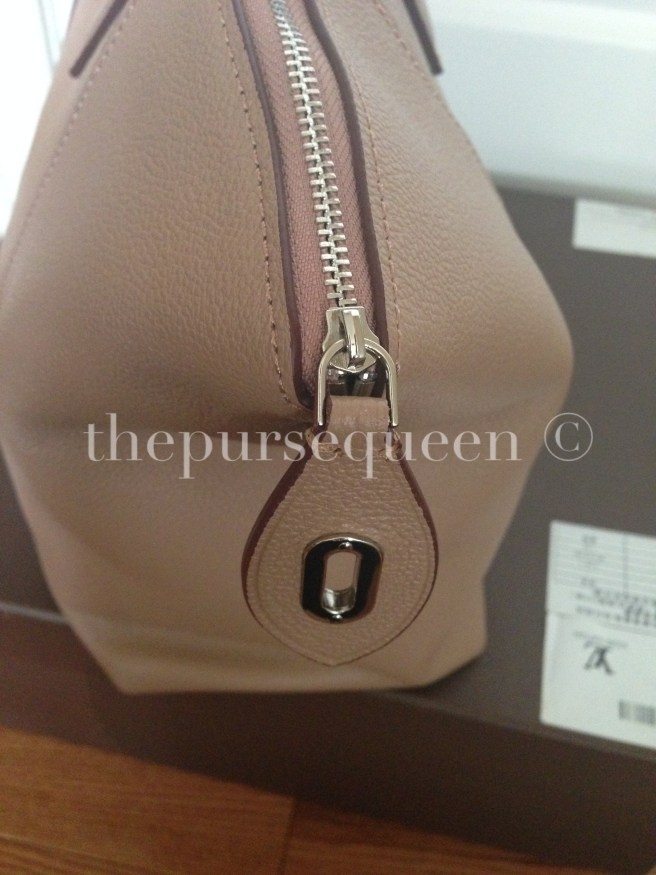 louis vuitton soft lockit beige replica vs authentic fake vs real side of bag