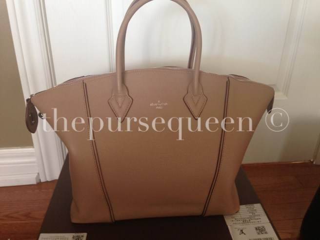 louis vuitton soft lockit beige replica vs authentic fake vs real