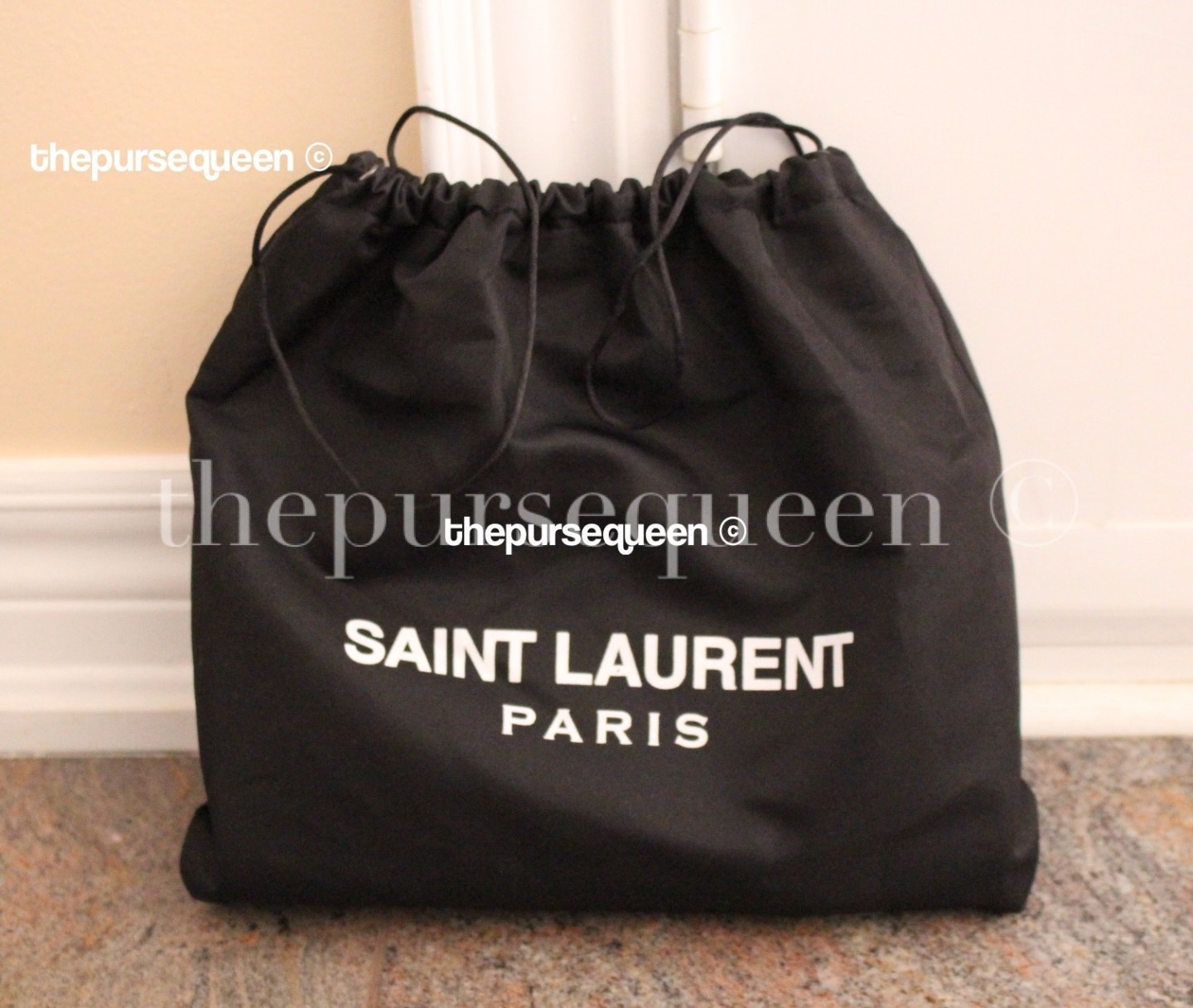 yves-saint-laurent-dustbag-ysl-cassandre-fake-replica-authentic