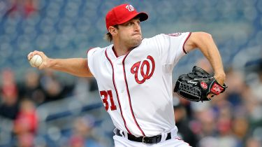 Max Scherzer throws a pitch in a game at Nationals Park (photo: sportingnews.com)