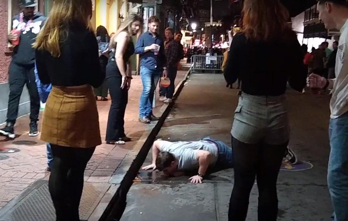 VIDEO: drunk tourist spills drink, licks it off Bourbon Street pavement