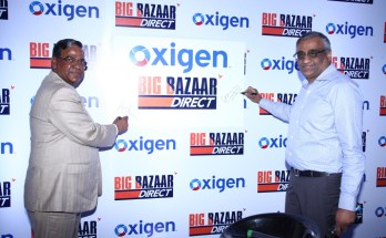 L to R - Mr. Kishore Biyani, Group CEO, Future Group and Mr. Pramod Saxena, Chairman & Managing Director, Oxigen Services.
