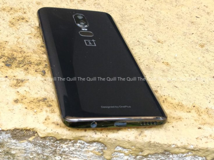 OnePlus 6 on a wall