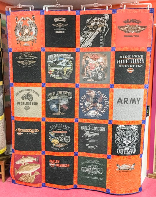 A colorful t-shirt quilt made from a collection of Harley Davidson t-shirts