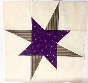 Quilt block with high and low points to make a wonky star block