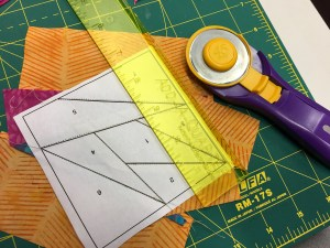 trimming a paper pieced block with the add-a-quarter rule