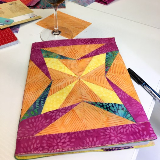bright colors add to the beauty of this paper and foundation pieced composition notebook cover