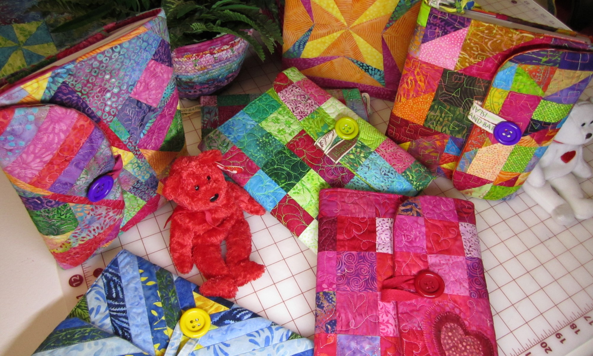 Quilted covers express creativity in the various designs used to cover a humble composition notebook