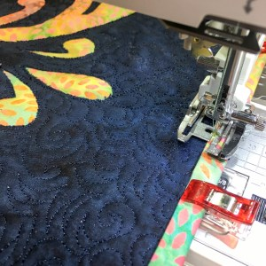 Machine Binding using Wonder Clips and colorful Island Batik Fabrics