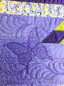 close up of hand guided signature butterfly of Karen Overton, The Quilt Rambler