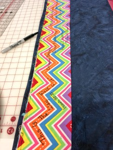 colorful hanging sleeve on the back of modern quilt