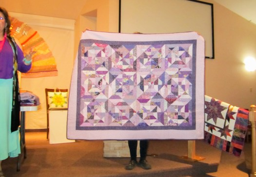 Scrappy quilt made from purple fabric