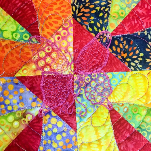 Hand guided signature butterfly lets everyone know this quilt was quilted by Karen Overton The Quilt Rambler