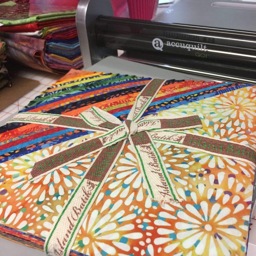 Beautiful stack of 10 inch precut Island Batik fabrics